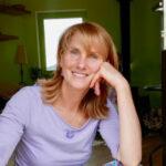Portrétová fotografie usmívající se fyzioterapeutky Renaty Vodičkové.